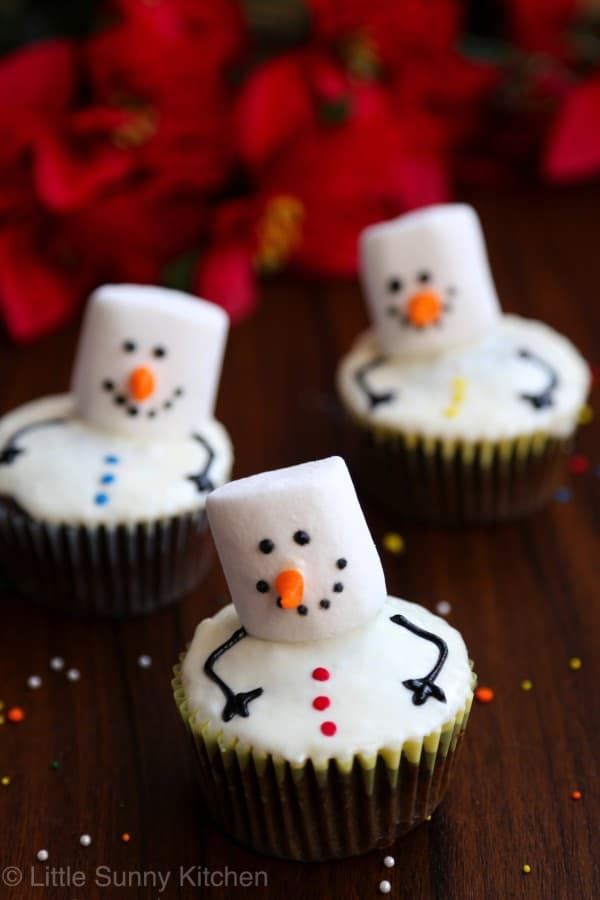 Snowman Cupcakes with vanilla frosting sprinkles funfetti marshmallows