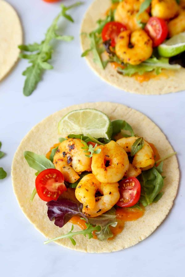 BBQ spicy saffron shrimp tacos served with homemade salsa, fresh salad leaves, lime and cherry tomatoes…